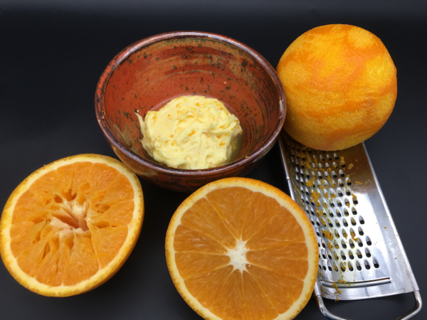 Soften the butter and mix with the orange zest along with the freshly squeezed orange juice.