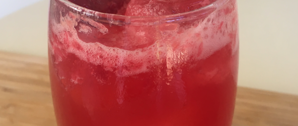 Serve over ice and garnish with mint or frozen raspberries, if desired.