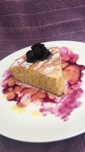 emon drizzle cake slice with blueberry