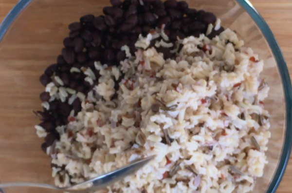 In a large mixing bowl (we used a Pyrex 3 Litre), combine rice and beans.