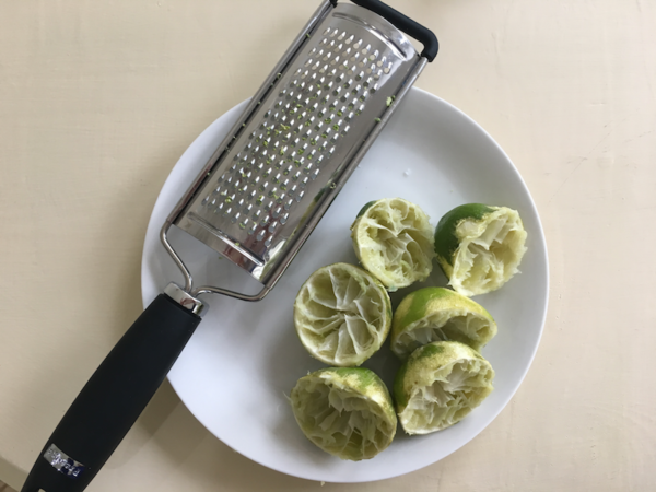In a medium sauce pan, add lime juice, lime zest, water and caster sugar.